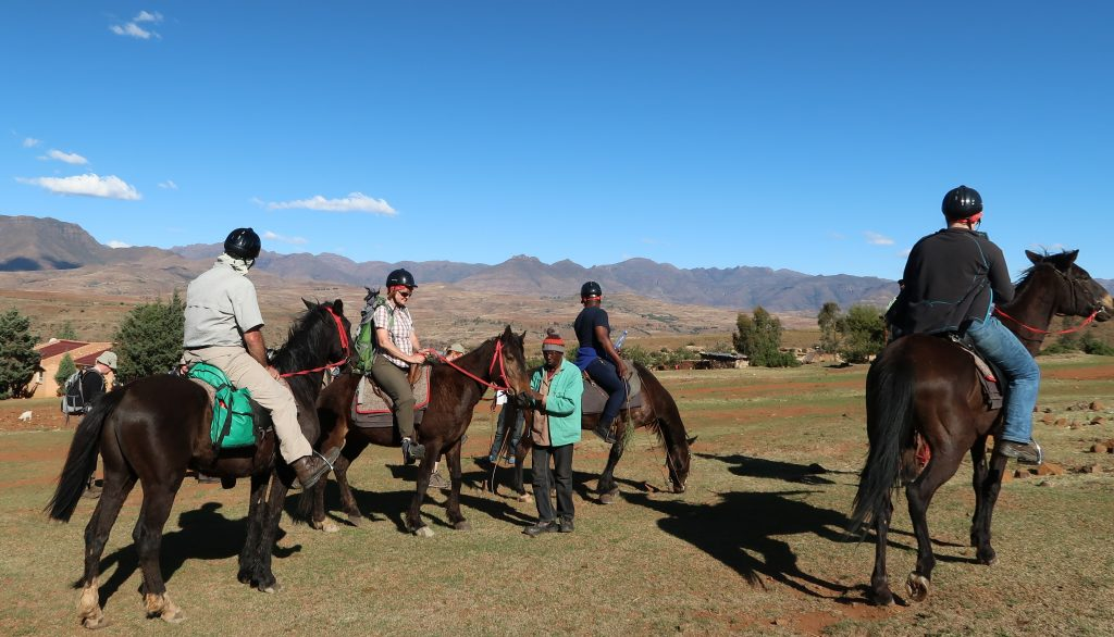 A Guide Assists a Rider, photo by Kelly Benning